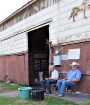 Ben Boring reminisces with son-in-law Bob Hughes outside the barn. It holds fond memories for both.