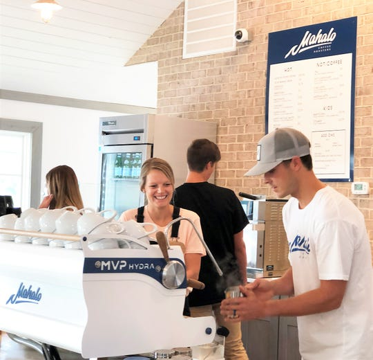 Ashton and Trevor Bayne serve customers on opening day, July 6, at Mahalo Coffee Roasters. 2019