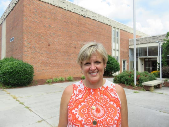 Debbie Sayers, the new principal of Bearden High, stands outside the school on July 3.