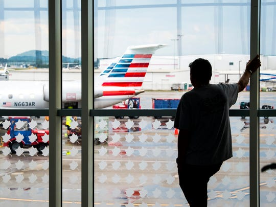 Visitors wait for arriving passengers at McGhee Tyson Airport in Knoxville on Friday, June 28, 2019.