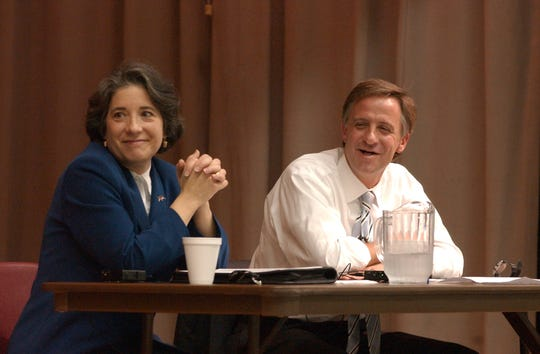 A question from the moderator at a debate brought a laugh from mayoral candidates Madeline Rogero, left  and Bill Haslam. The debate was held at the John T. O'Connor Senior Center.