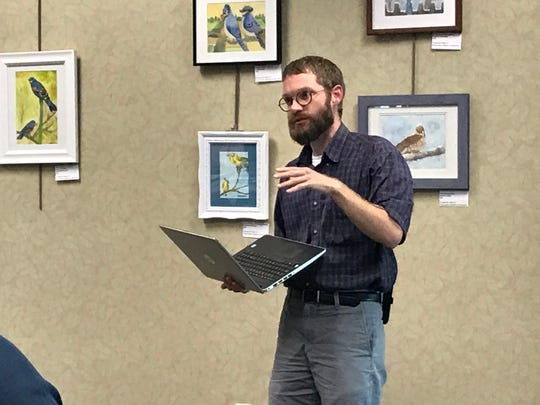 Zachary Baiel presents his ideas for chances to the West Lafayette Public Library during the public hearing Wednesday.