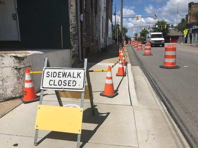 Orange barrels and signs went up this week to warn pedestrians and drivers along South Street about the deteriorating conditions of the E.M. Weaver Building, a prominent, 152-year-old structure at 1600 Main St., at Lafayette's Five Points intersection.