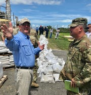 Louisiana Gov. John Bel Edwards talks with Army National Guard members at Chalmette Refining in New Orleans, La., on Thursday, July 11, 2019.