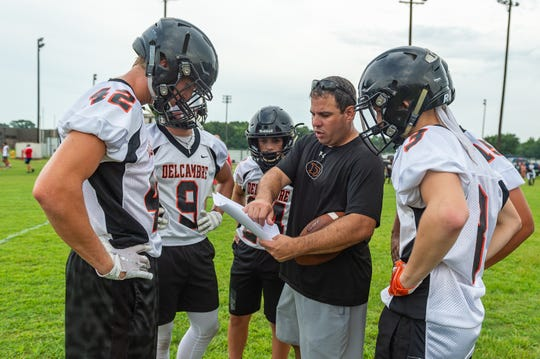 Delcambre football coach Artie Liuzza talks to his players Wednesday at the QuickSlants 7-on-7 High School Football Tournament.