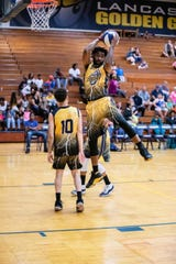 Lancaster Thunder's Jae McCrae (right) and his teammates will play for the North American Basketball League championship this weekend at Thomas More College in Kentucky.