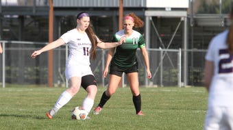 Jackie Jarvis talks about her love for all three sports she played at Fowlerville.