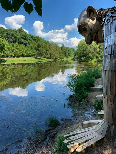 Little Nis sits over the Olmsted Ponds at Bernheim Forest, one of three Forest Giants created by Danish artist, Thomas Dambo to celebrate the 90th anniversary of Bernheim Wednesday, July 10, 2019 in Clermont, Ky. According to Mark Wourms, Bernheim has never had a threat like the proposed LG&E pipeline in its 90 year existence and they are battling that as well as a highway expansion project now at the same time.