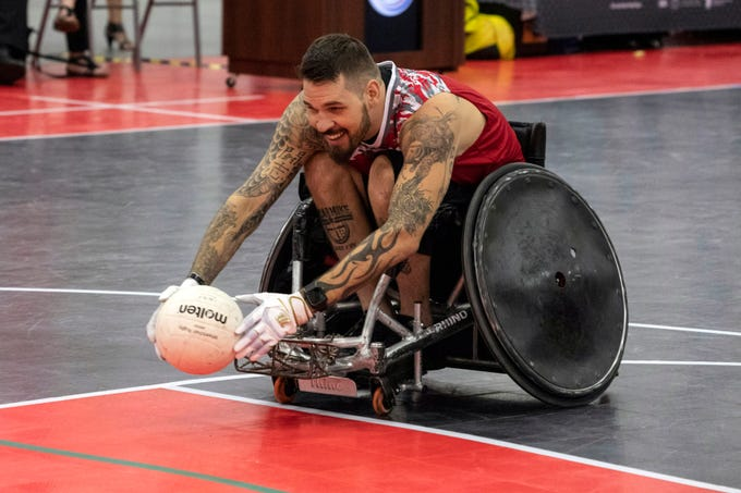 Mason Simons goes in for another score during a quad rugby exhibition match at the National Veterans Wheelchair Games on Thursday. 7/11/19