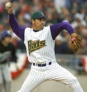 Louisville Riverbats pitcher Osvaldo Fernandez throws during April 2000.