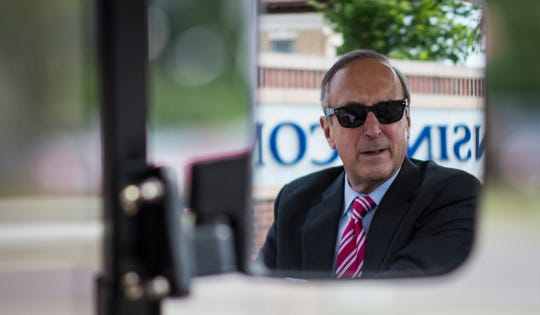 """We're the people's college,"" Lansing Community College President Brent Knight said while driving a golf cart during a campus tour Wednesday, July 10, 2019.  Knight is proud of the many changes and improvements made on campus during his time at the helm."