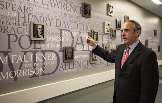 "Lansing Community College President Brent Knight talks about this ""Writers Wall,"" designed by writing faculty at the college. He is retiring in June and the college is working to find his replacement."