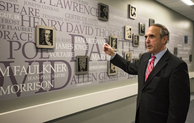 """Lansing Community College President Brent Knight talks about this """"Writers Wall,"""" designed by writing faculty at the college. He is retiring in June and the college is working to find his replacement."""
