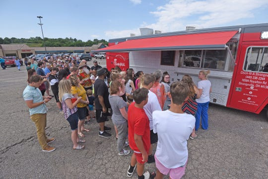 More than a hundred hungry people stood in line waiting for the Chick-fil-A food truck to open on Thursday.