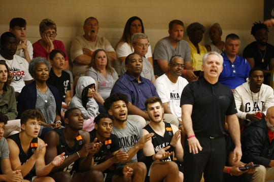 Kylan Chandler (blue shirt), the father of Briarcrest star Kennedy Chandler, looks on during his son's game at Peach Jam on Thursday.