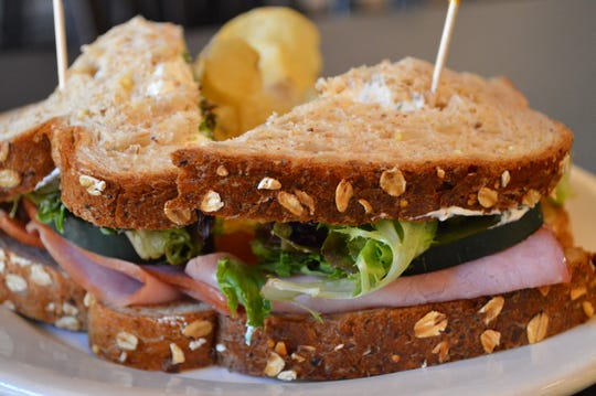 The ham and chive cheese sandwich at Mountain Top Coffee has ham, chive cream cheese, cucumbers and spring mix. It's served on wheat bread, and comes with chips and a pickle for $9.50.