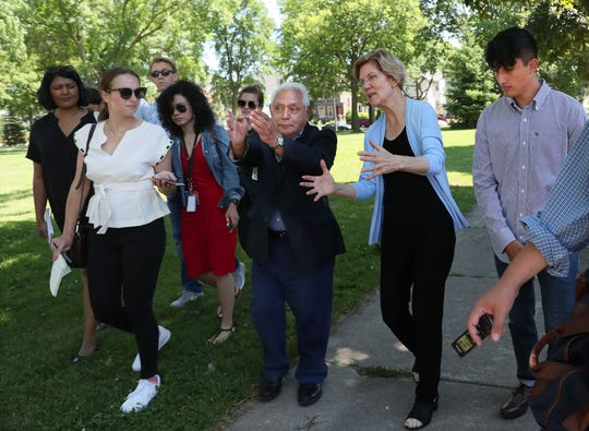 Democratic presidential candidate Sen. Elizabeth Warren, second from right, takes a tour of the Walker's Point neighborhood on Milwaukee's south side on July 11, 2019. With Warren is 6th District Milwaukee School Board member Tony Baez, center, and Marquette University student Eduardo Perea-Hernandez, right, a neighborhood resident. Warren was in Milwaukee for a presidential forum conducted by the League of United Latin American Citizens.