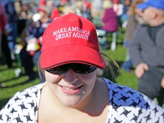 Rebecca Thompson of Pleasant Prairie, a Donald Trump supporter, dons her Make America Great Again hat at a rally at the Walworth County Fairgrounds in Elkhorn Oct. 8, 2016. The event came a day after the release of a video showing Donald Trump making crude and sexually charged comments about women that sent shock waves through the Republican candidate's campaign and left GOP leaders scrambling.