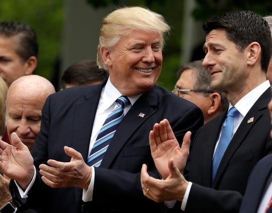 President Donald Trump talks to House Speaker Paul Ryan of Wis. in the Rose Garden of the White House in Washington, Thursday, May 4, 2017, after the House pushed through a health care bill.
