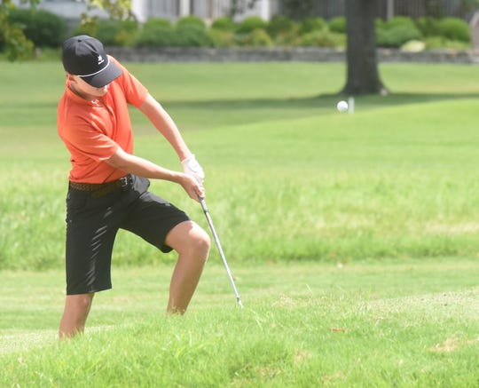 Henry Cole of Fayetteville chips onto the  ninth green during first round play of the Chuck Morton Memorial Junior Golf Tournament at Big Creek Golf & Country Club.