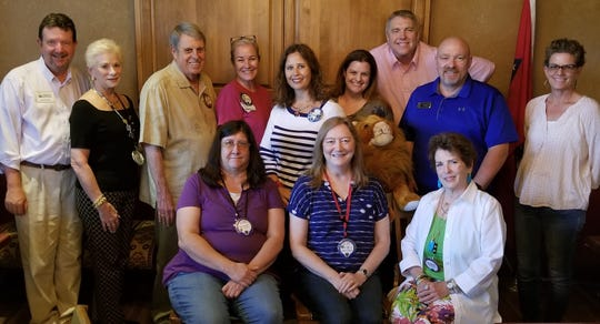 The Mountain Home Lions Club has elected new officers for the 2019-20 year. Pictured are: (first row, from left)Mia Schwierzke, 2nd Vice President;Janet Evans,Membership Chair; Robin Hawkins, Past President; (second row)George Truell, Past President; Cynthia Dalrymple, 2nd Vice President Auction;Larry Luman, Member at Large;Beverly Sandvos,Secretary;Angela Broome,President; Kristen Varas,3rd Vice President Programs; Gary Stricklin, 1st Vice President Sight Care;Sam McMaster, Treasurer; Caroline Chentnik, Lion Tamer. Not pictured: Cindy Costa, Tail Twister.The installation of the officers was held at the annual banquet.