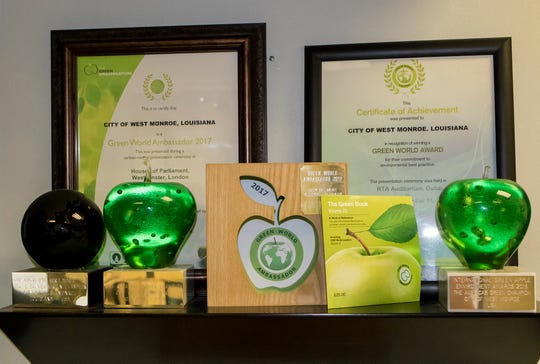 The West Monroe Sparta Reuse Facility displays its Green Apple and Green World awards for its eco-friendly use of naturally occurring green algae to help clean the city's waste water to supply 5 million gallons of water daily to Graphic Packaging in order to cut down the company's water draw from the natural aquifer which supplies the city's water needs.