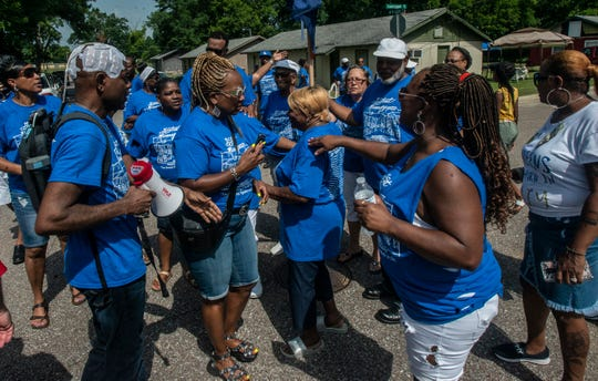 Columbus Cook directs family and friends as they form a cross in the streets of his old neighborhood in Wetumpka on Saturday, July 6, 2019.