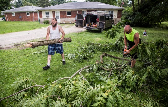 Downed limbs and damage to roofs and siding plagued the Morningside neighborhood on the north side of Muncie following last night's storms.