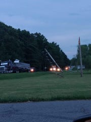 A tractor trailer on Highway 48 in Dickson pulled down power lines and poles Wednesday night, causing 1,500 to lose power for several hours.