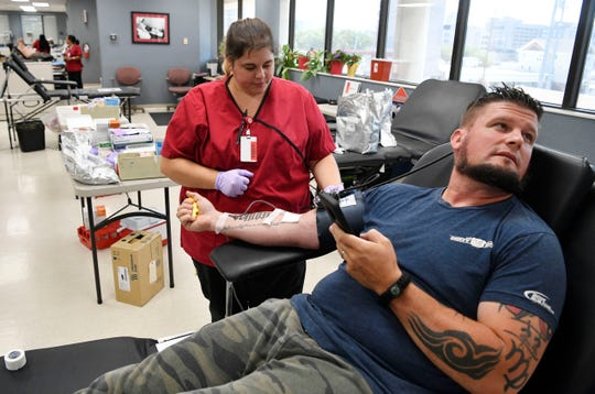Phlebotomist Kate Abbgy keeps an eye on Russ Terry as he donates red blood cells at the American Red Cross on Charlotte. The Red Cross issued a plea for blood donors Thursday morning, as it doesn't have enough blood to make it another three days Thursday, July 11, 2019, in Nashville, Tenn.