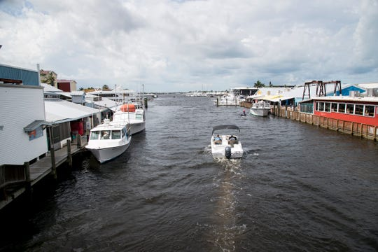 Boaters pass by Tin City into Naples Bay on Thursday morning, July 11, 2019, in Naples. FWC and law enforcement recently targeted boats in Collier County for water quality violations and found nearly 25 percent of them not properly handling raw sewage.
