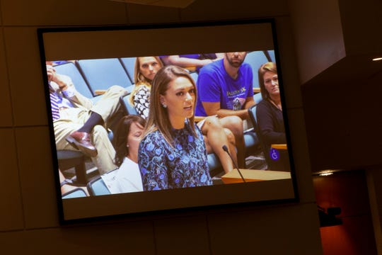Annaleah Miravalle, K-8 academic dean at Mason Classical Academy, speaks in support of the school during a special School Board meeting at the Collier County School District office in Naples on Thursday, July 11, 2019.