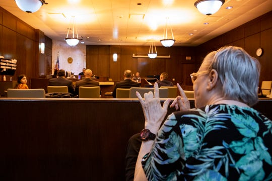 Susan Priser, mom of Rocquel Priser, gestures to her daughter that she loves her at a competency hearing on Thursday, July 11, 2019, at the Collier County Courthouse in Naples. Rocquel Priser, 39, faces a second-degree murder charge in connection with the killing of Rocky Priser.