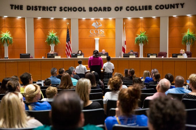 Pearline Foster, center, stands with her children, Othniel, 9, left, and Rebekah, 12, right, both students at Mason Classical Academy, as she speaks in support of the school during a special School Board meeting at the Collier County School District office in Naples on Thursday, July 11, 2019. The Collier County School Board unanimously voted to proceed with mediation with Mason Classical Academy and to defer any move to terminate the school's charter until after mediation.