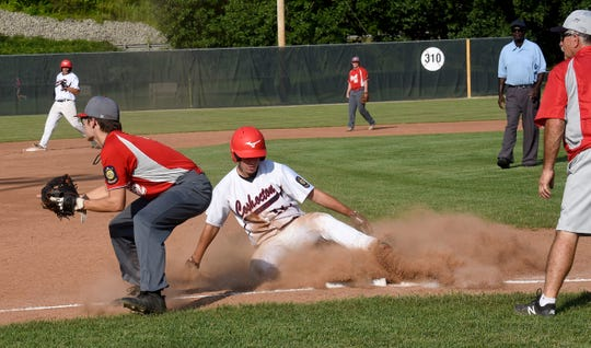 Utica Post 92 third baseman Trace Berry can't make the connection in time to tag out Coshocton Post 65 baserunner Brody Hammersley. Coshocton defeated Utica 11-9 on Wednesday, July 10, 2019 at Coshocton Lake Park.