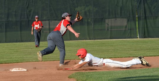 Utica Post 92's Garrett Meyers catches a wide throw while Coshocton Post 65 baserunner Nathan Fauver slides in to second. Coshocton defeated Utica 11-9 on Wednesday, July 10, 2019 at Coshocton Lake Park.