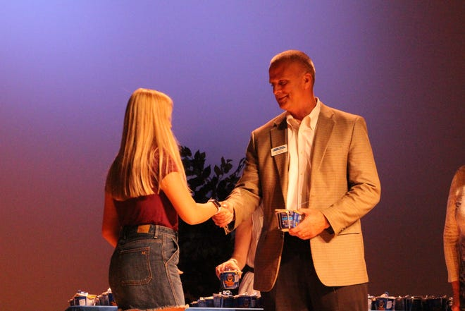 Bailey Moraine (left) accepts the Scott Henry Award at the Licking County Foundation's 2019-20 Scholarship Awards Celebration on Wednesday, July 10, 2019.