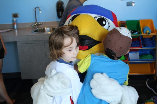 The Puzzle Piece Playhouse is a dedicated space for children with autism to watch a ballgame.