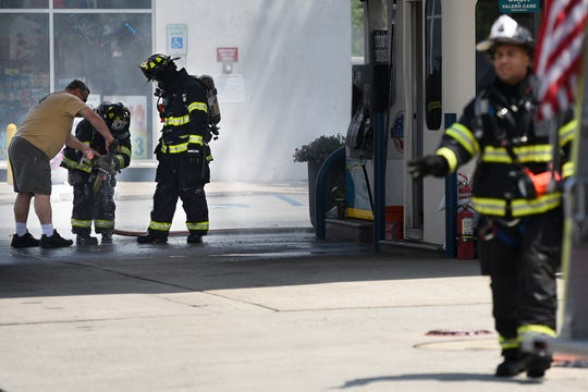 Firefighters on the scene of car fire at the Valero gas station in Hasbrouck Heights on Thursday July 11, 2019.