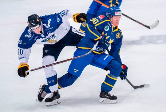 Finland's Eatu Luostarinen and Sweden's Jesper Boqvist vie for the puck during the Beijer Hockey Games match between Sweden and Finland at Hovet arena in Stockholm, Sweden on February 10, 2019..
