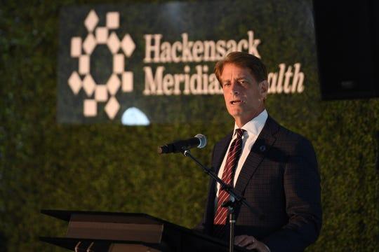 Robert Garrett, FACHE, speaks during the Class of 2019 White Coat Ceremony at Hackensack Meridian School of Medicine at Seton Hall University in Nutley on Thursday, July 11, 2019.