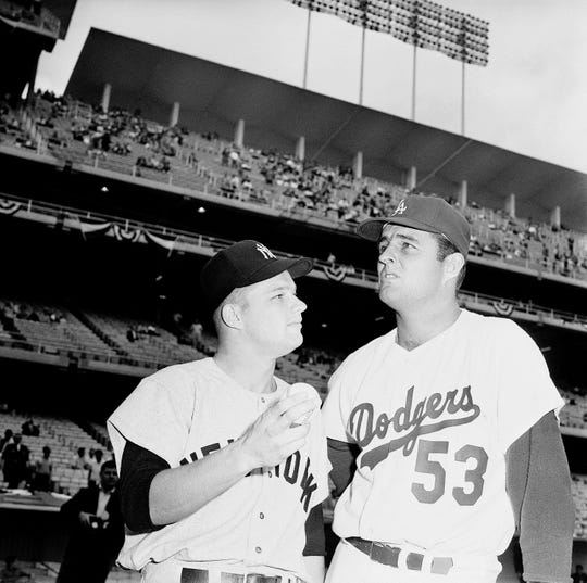 Jim Bouton of the New York Yankees and Don Drysdale of the Los Angeles Dodgers pose in Dodger Stadium before the start of today's third World Series game, October 5, 1963.They will be on the mound for their respective teams.
