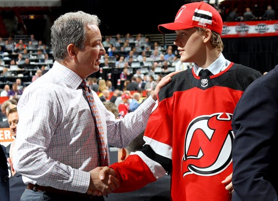 Jesper Boqvist meets with New Jersey Devils executives after being selected 36th overall during the 2017 NHL Draft at the United Center on June 24, 2017 in Chicago, Illinois.