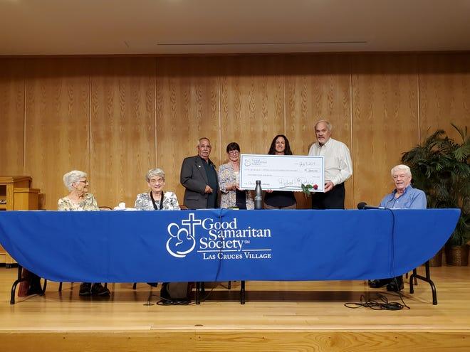 Good Samaritan Society – Las Cruces Village Executive Director Bob McDonald, Senior Living Manager Marty Hart, and resident Judy Waite present a check for $2,000 to Nicole Martinez of Mesilla Valley Community of Hope.