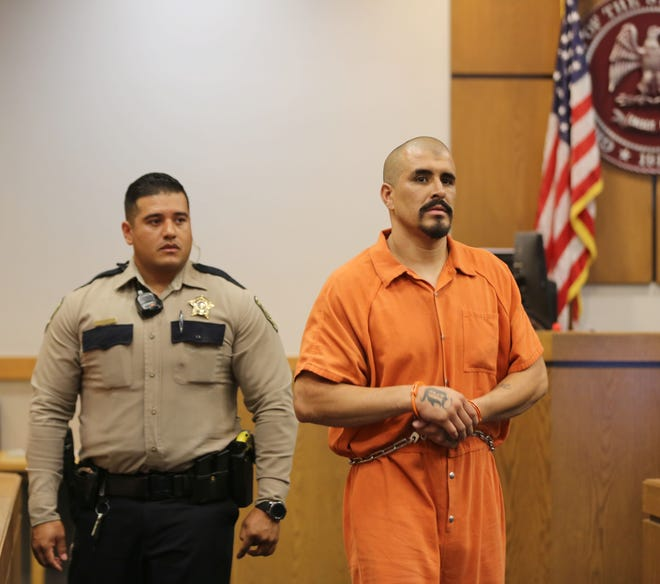 Ruben Sanchez is led to his pretrial detention hearing, in Las Cruces in Third Judicial District Court on Thursday July 11, 2019.