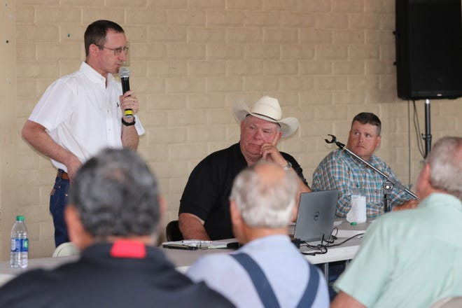 Clay Koontz of Stantec, left, with Eddy County Commissioner Ernie Carleson and Eddy County interim county manager Wesley Hooper on July 10 in Loving.