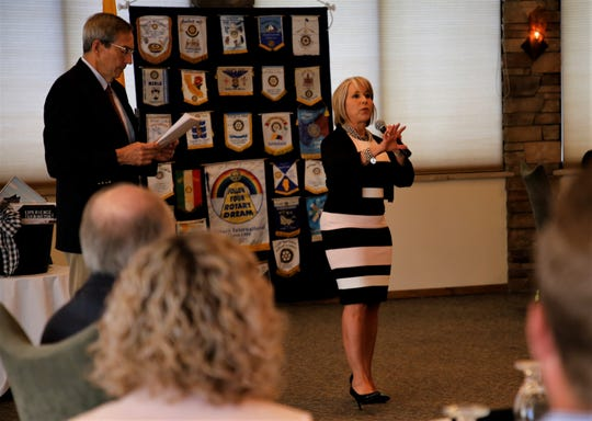 Rotarian and member of the Farmington Metropolitan Redevelopment Area commission John McNeill asks Governor Michelle Lujan Grisham a question, Thursday, July 11, 2019, during a meeting at the San Juan Country Club.