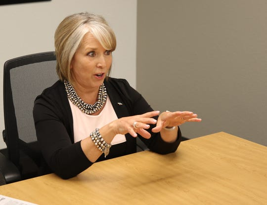 Gov. Michelle Lujan Grisham responds to a question during a July 11 interview in Farmington.