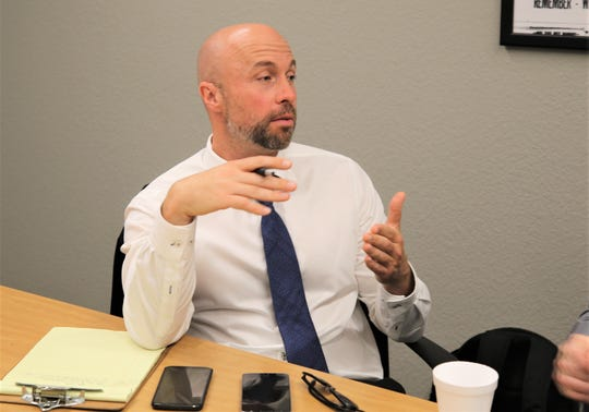 Bill McCamley, cabinet secretary for the New Mexico Department of Workforce Solutions, gestures during an interview with The Daily Times staff on July 11, 2019.