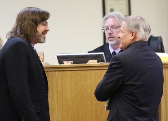 Attorney Eric Morrow, left, talks with San Juan County Assistant District Attorney Ned Fuller before the preliminary hearing for Martha Crouch in Aztec Magistrate Court on July 11 in Aztec.
